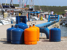 Tourist Gas Cylinders Stand On...
