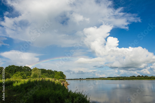 Deurstickers Rivier Oka river in summer Sunny day with rainbow