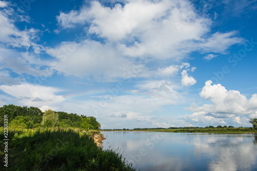 Oka river in summer Sunny day with rainbow
