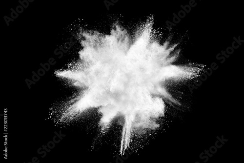 Valokuvatapetti White powder explosion isolated on black background.