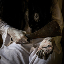 Women In White Dress Holding A Knife On Hands Close Up.  Concpet Of Horror And Holloween.