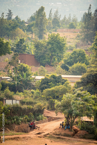Fotografiet  View of bakclit trees and dirt paths on a hillside in Nyamirambo, an outlying, s
