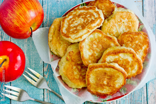 Sweet apple pancakes on plate top view