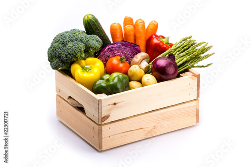 Fotobehang Groenten Pine box full of colorful fresh vegetables on a white background