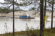 canvas print picture - The dredger extracts sand from the quarry in the forest.