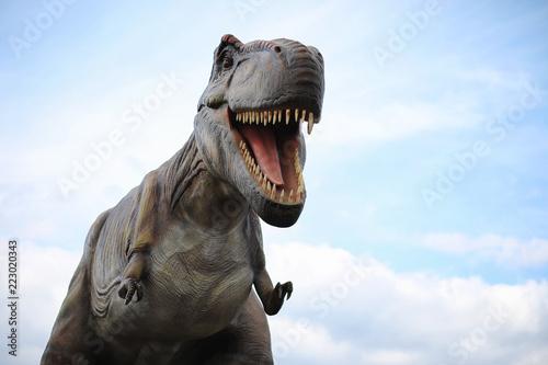 Naklejka premium Park dinozaurów. Dinozaur na tle przyrody. Zabawka d