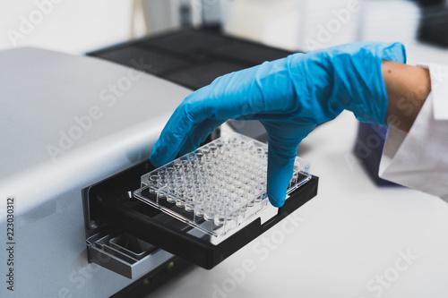 Worker in rubber gloves doing medical test