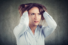 Stressful Woman Squeezing Head
