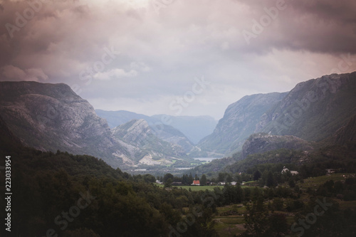 Poster Grijze traf. Mountain landscape Norway, colorful sky and houses in the autumn