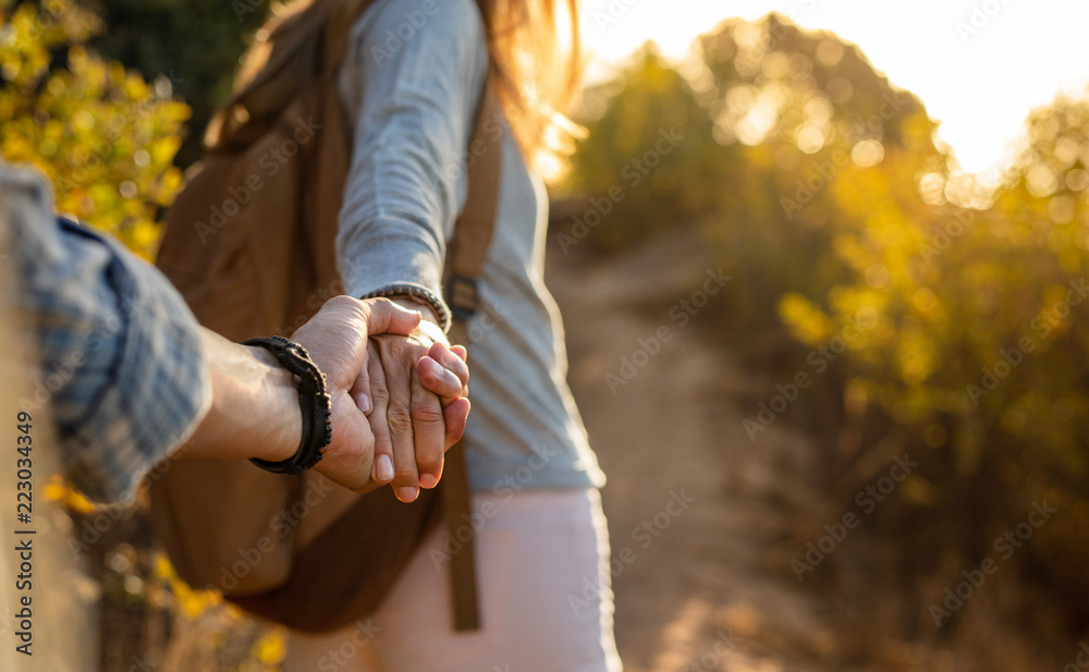 Fototapeta Hiking couple holding hands