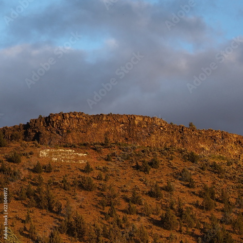 Fotografie, Obraz  A Butte in Central Oregon with a golden glow as the sun sets for the day