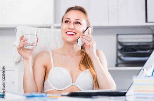 Keuken foto achterwand Akt Portrait of smiling girl in underwear in the office