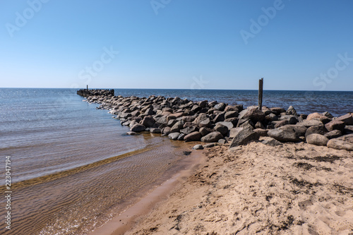 Poster Zalm old stone brakewater in the Baltic sea