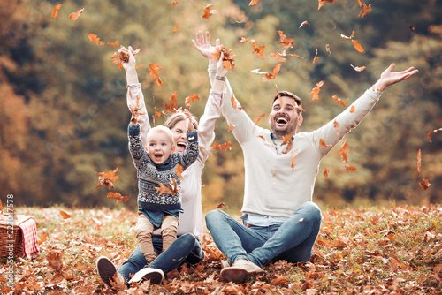 Obraz Happy family having fun in autumn forest - fototapety do salonu