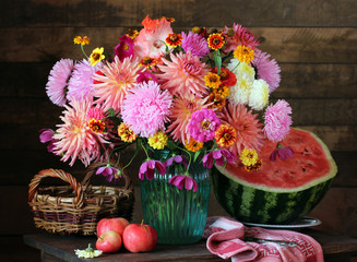Autumn still life with a bouquet of asters and dahlias