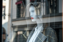 Closeup Of Winter Coat With Hood On Mannequin In Fashion Store Showroom For Women