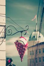 Big Plastic Ice Cream Cone Sign Over Blue Sky On City Street