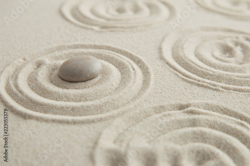 Deurstickers Stenen in het Zand Pyramids of gray zen stones on the sand with wave drawings. Concept of harmony, balance and meditation, spa, massage, relax