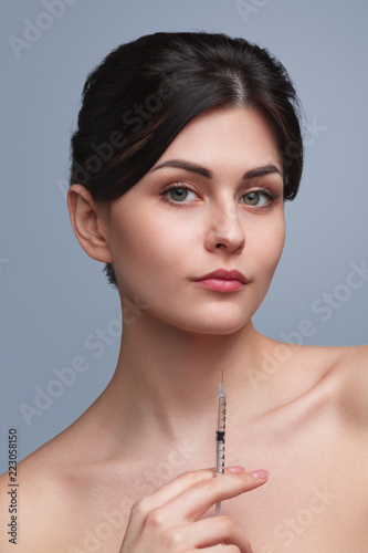 Fotografie, Obraz  Woman with cosmetic syringe