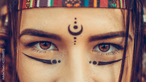 Stampa su Tela Native American Girl eyes close up, young attractive woman warrior looks at came