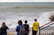 Storm on the Black Sea. Dirty water and big waves. People on the shore
