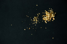Gold Flakes On Black