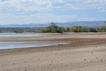 Increase Of Dry Beach Land With Decreasing Water Level At Lake Standley Reservoir In Westminster Colorado