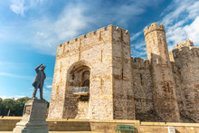 Caernarfon Castle In North Wales With Bronze Statue Of David Lloyd George Prime Minister Of The United Kingdom, 1916-22.