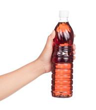 Hand Holding Bottle Of Fish Sauce Isolated On White Background.