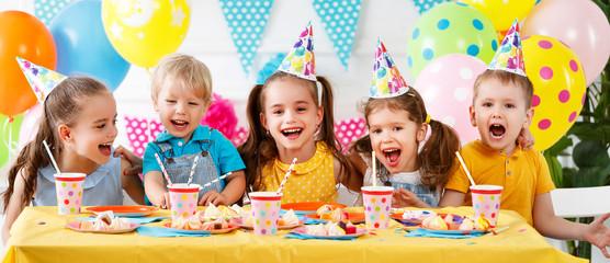 Fototapeta children's birthday. happy kids with cake