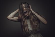 Crazy, Deranged Young Woman Sc...