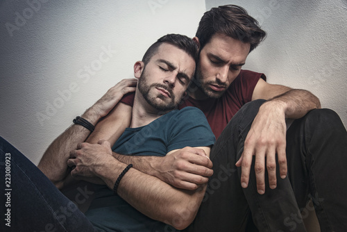 Gay couple going through rough times, comforting each other, experiencing quiet Canvas Print