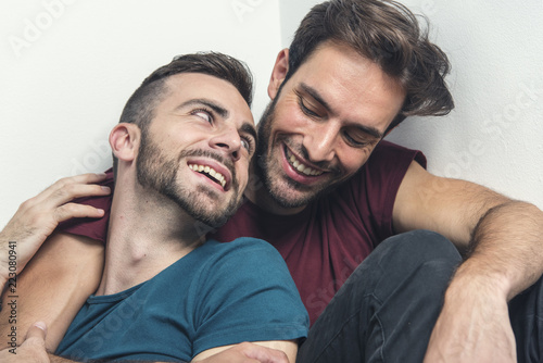 Happy gay couple embraced, joking and having fun in an intimate hug Canvas Print