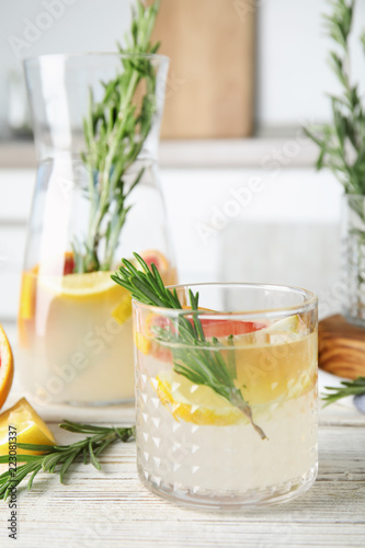 Foto op Canvas Cocktail Refreshing grapefruit cocktail with rosemary on table