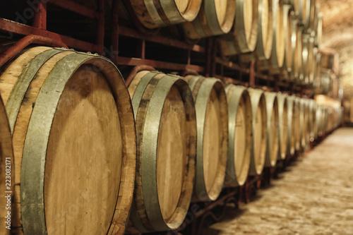 Obraz na plátně Large wooden barrels in wine cellar, closeup