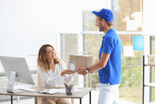 Young Woman Receiving Parcel F...