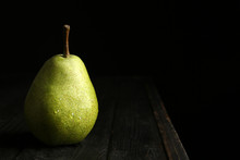 Ripe Pear On Wooden Table Agai...