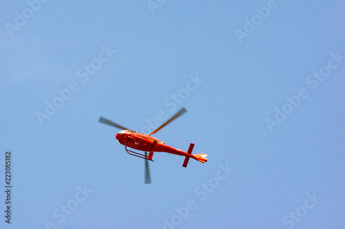 Poster Helicopter Red Helicopter Low