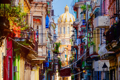 Canvas Print Colorful street in Old Havana with the Presidential Palace on the background