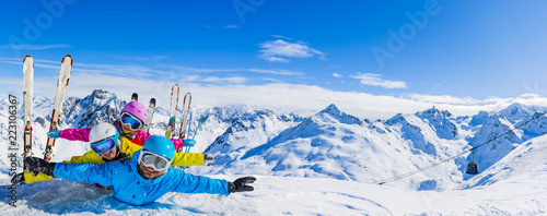 obraz dibond Happy family enjoying winter vacations in mountains . Ski, Sun, Snow and fun.