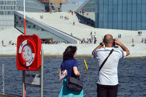Foto op Canvas Theater Tourists take pictures modern National Oslo Opera House building