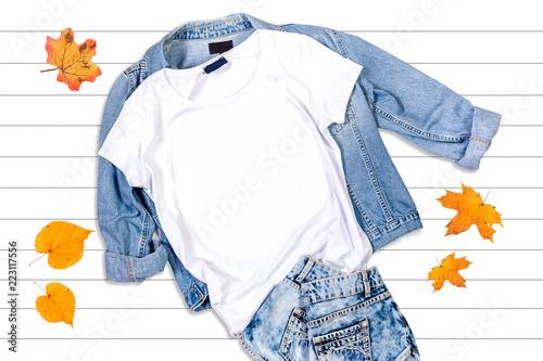 Obraz na plátne White T-shirt and Jeans Jacket on a White Background