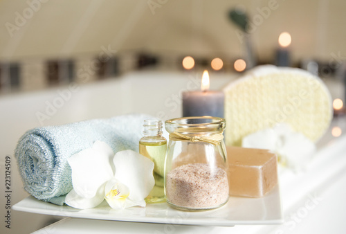 Photo White ceramic tray with home spa supplies in home bathroom for relaxing rituals