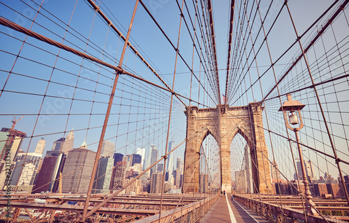 Deurstickers New York City Brooklyn Bridge at sunrise, vintage stylized picture, New York City, USA.