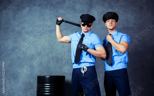 Fényképezés  dancers wearing costumes of policemen