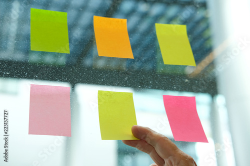 Hand Hold Adhesive Notes On Glass Wall Sticky Note Paper Reminder