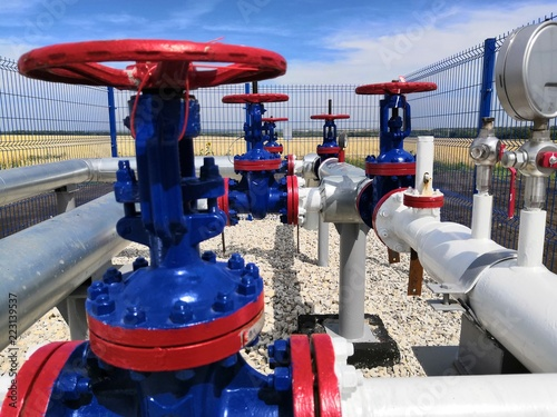 Photo  Gate valves of the switching unit in the oil pipelinee