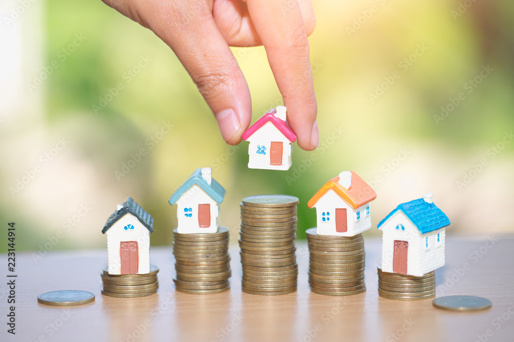 Photo & Art Print Mini house on stack of coins, Real estate