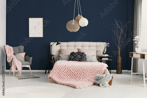 Real photo of knot cushion and pastel pink coverlet placed ...