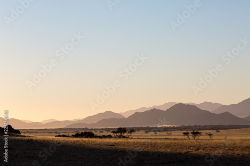 Poster Beige landscape of africa in the sunset